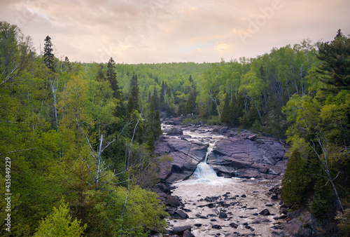 High angle view of waterfall and trees along north shore of Lake Superior in Minnesota #435849229