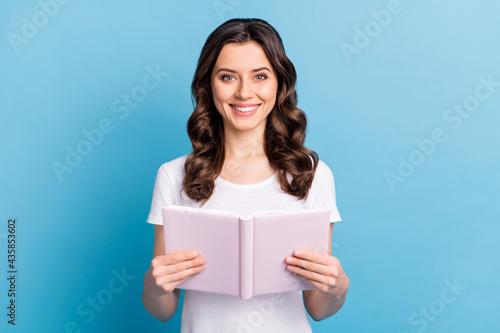 Stampa su Tela Photo of young attractive girl happy positive smile read book notebook story nov