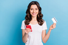 Photo Of Pretty Cute Young Lady Dressed White Outfit Holding Modern Gadget Bank Card Isolated Blue Color Background