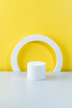Abstract Empty Podium Of Cylinder Shape On Yellow Background For Product. 3D Rendering. Minimal Concept.