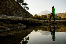 Wonderful View Of Water Of Mountain Lake And Young Woman Tourist Standing Near It