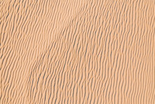 Wind Wave Vortices In Sand Background From Aerial Top View