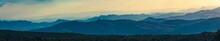 Super Wide Abstract Panorama Of Hazy Mountain Hills, Natural Background, Mountain Silhouettes