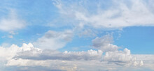 Bright Sky Background With Few Cirrus Clouds Above And Larger Ones In Lower Part