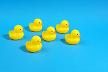 Yellow Rubber Ducks On A Blue Background. Minimal Summer Concept.