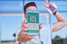 Hand Man Holding Smartphone Displaying On App Mobile Valid Digital Green Vaccination Certificate For Covid-19. Immunity Vaccine Passport, Vaccination Certificate, Health Passport For New Normal Travel