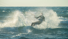 Kitesurfer In A Splash Of Water