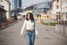 A Beautiful Young Brunette Hipster Girl On The Street Of Her City