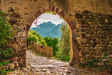 Old Castle Gate With A View Of South Tyrolean Mountains In Italy.