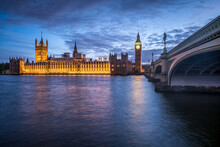 London Skyline Along The River Thames At Night With Houses Of Parliament And Big Ben
