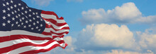 Large Flag Of Usa  Waving In The Wind On Flagpole Against The Sky With Clouds On Sunny Day. 3d Illustration