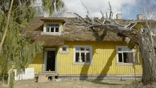 A Huge Yellow Abandoned House In The Lawn With The Tall Old Tree On The Side