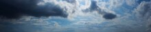 Panorama Blue Sky Background With Storm And Tiny Clouds