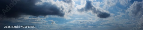 Fotografie, Obraz Panorama blue sky background with storm and tiny clouds