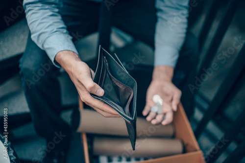 Fotografija Office worker lost his job and open a wallet without money