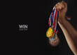 canvas print picture - different medals in hand - Victory Concept - copy space, mockup