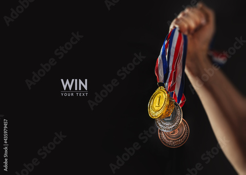 Fotografie, Obraz different medals in hand - Victory Concept - copy space, mockup