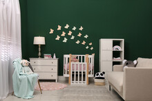Beautiful Baby Room Interior With Stylish Furniture And Comfortable Crib
