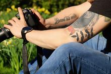 Man With Tattoos Taking Photos