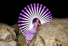 Woman Standing On Pink Umbrella