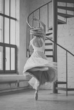 Rear View Of Woman Dancing By Staircase