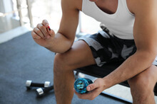 Sportsman With Bottle Of Pills In Gym, Closeup. Doping Concept