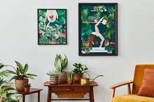Domestic Interior Of Living Room With Vintage Retro Shelf, A Lot Of House Plants, Cacti, Wooden Mock Up Poster Frame On The White Wall And Elegant Accessories At Stylish Home Garden. Template.