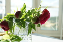 Bouquet Of Red Peonies In A Vase On The Table