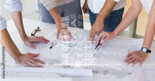 Composition of team of architects looking at blueprint and 3d architectural digital interface screen