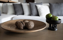 Dry Cerbera Odollam Or Pong Pong Seed On A Wooden Plate And Orange Fruits In A Bowl In The Living Room.