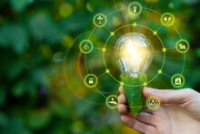 Green Energy Innovation Light Bulb With Future Industry Of Power Generation Icon Graphic Interface. Concept Of Sustainability Development By Alternative Sources Renewable. Ecology And Environment.