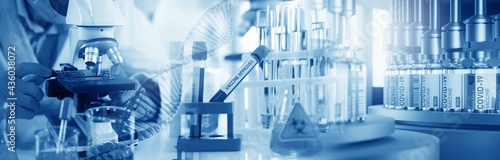 Fotografija Panoramic web banner of Doctor use microscope in a medical research lab or science laboratory, study for making vaccine to protection a coronavirus COVID-19