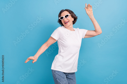 Portrait of attractive cheerful woman dancing rest good mood free time isolated Fototapet
