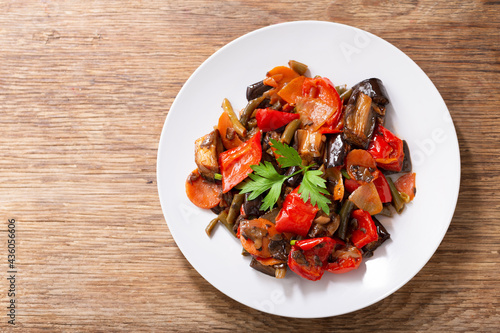 plate of roasted vegetable with parsley, top view