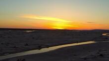 Forward Ascending Shot Of Stream Flowing Amidst Landscape Against Sky During Sunset - Denali, Alaska