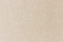 The Surface Of A Flat Cardboard Sheet. Uniform Light Brown Texture.