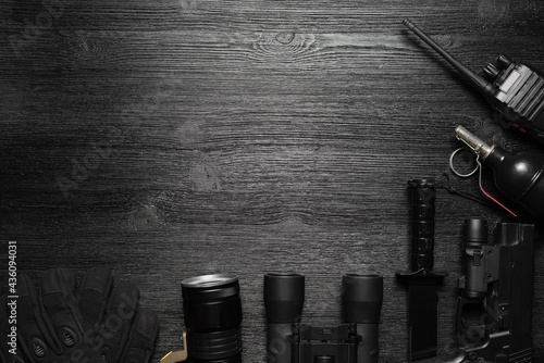 Black airsoft gun, walkie talkie radio station, binoculars and knife on the black flat lay background with copy space Fototapet