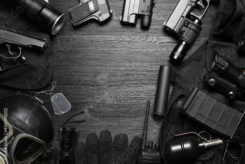 Fotografia, Obraz Airsoft equipment on the black flat lay background with copy space