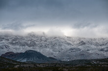 Low Lying Clouds And Snow Cover The Franklin Mountains In El Paso Texas.