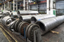 Pipe Factory Production Line With Steel Tubular Pipes On Floor, Metalwork Heavy Industry.