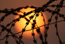 Sunset In The Barbed Wire