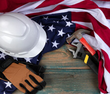 Happy Labor Day Background With American Flag And Construction Equipment Tools On Faded Blue Wood