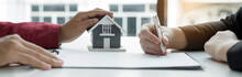 Real Estate Agents Offer Sale Home Insurance And Close The Sale Immediately After The Customer Signs A Purchase Contract Under A Formal Agreement. Real Estate Home Insurance Concept