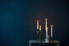 Candlesticks With Burning Candles On  Dark Blue Background