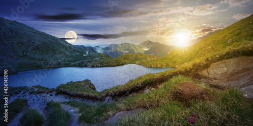 day and night time change concept above summer landscape with lake on high altitude. beautiful scenery of fagaras mountain ridge. open view in to the distant peak beneath a clouds with sun and moon #436145090