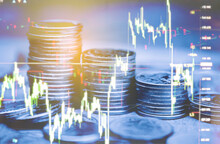 Double Exposure Of Money Coin, Stock Market Or Forex Trading Graph And Candlestick Chart Suitable For Financial Investment Concept.