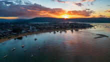 Aerial Sunrise Waterscape With Boats And Cloud Cover