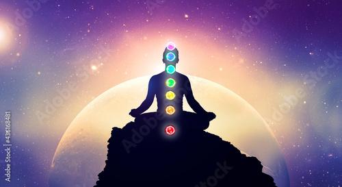 Obraz na płótnie Meditating men in yoga lotus position with chakras