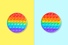 Round Rainbow Silicone Kids Toys Antistress Pop It Or Simple Dimple From Two Sides On A Blue And Yellow Background