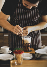 Barista Carefully Decorating Creamy Foam Of Iced Coffee By Using Toothpick To Draw Chocolate Patterns Onto It Like Spider Net To Make It Look More Attractive To Be Drunk
